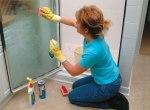 woman_cleaning_shower_door_aasc